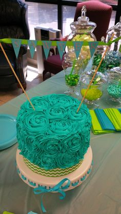 Turquoise and lime green chevron rosette cake for a baby boy shower