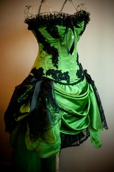 Green and black corset dress