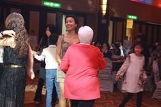 This is a picture of people dancing in the Tainan Christmas Party. In this picture, I used a high ISO, since there was a low light provided from above, and since the two women didn't get the spotlight. I used a slightly high shutter speed, since they were dancing and moving. This allowed me to capture the woman's happy, smiling moment. I used high aperture to blur out the surroundings. Also, I used the rule of thirds to place the two in the middle, between the 2 vertical imaginary lines.