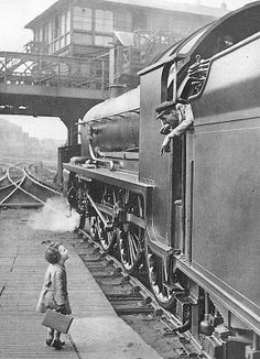What is there about little boys and trains? Charming black and white old-timey photo shows their train love has not diminished in 100 years ~ Little boy talking to the locomotive crew, Waterloo Station, 1924 From Southern Railway's advertising Vintage Pictures, Old Pictures, Old Photos, Black White Photos, Black And White Photography, Waterloo Station, Old Trains, Photocollage, Train Travel