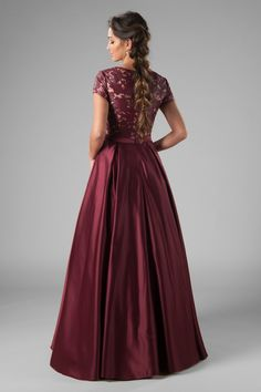 Go ga-ga for this ultra-modern, ultra-beautiful modest prom gown! The lace pattern is made with pleather (that's fabric leather), and you'll likely knock everyone's heels off! Gown shown in burgundy. Modest Prom Gowns, Bridesmaid Dresses, Prom Dresses, Formal Dresses, Bridesmaids, School Dresses, Vintage Prom, Luxury Dress, Ball Gowns