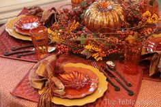 Thanksgiving tablescape, love the leaf plates, mercury orange pumpkin in the middle of centerpiece