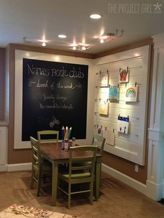 Basement idea....Kid's nook - love the framed chalk board and art display.