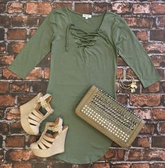 The Fun in the Sun Tie Dress in Olive is comfy, fitted, and oh so fabulous! A great basic that can be dressed up or down! We love the added detail of the tie front!     Sizing:  Small: 0-3 Medium: 5-7 Large: 9-11  True to Size with a Stretchy, Fitted Look. Size Up if you don't care for super fitted dresses :)  *This is still a fitted dress. It's not a loose/flowy cut*   #funinthesun #slate #tiedress #dress #adorable #fitted #flirty #fabulous