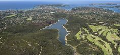 Manly, on the Northern Beaches of Sydney. Manly Dam in foreground, ocean to the left, Sydney Harbour to the right.
