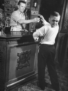 Revolving head man. Martin Laurello, turning his in complete opposite direction as he takes a glass of beer from a bartender