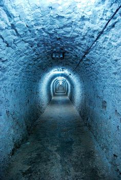 A tunnel that leads to hundred meters below ground in a natural salt mine,  Transylvania, Romania. www.romaniasfrinds.com