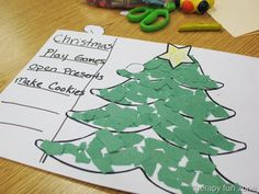 Making Christmas trees with torn paper to work the small muscles of the fingers and hands.