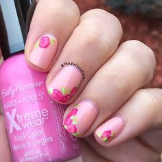 Freehand rose nail art- base is @essence_cosmetics Nude Glam Peach and Cream, roses are hand painted with @sallyhansenca XtremeWear polishes!
