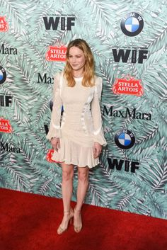 Brie Larson's funky all-white dress is giving us trendy wedding dress goals that will have you rushing to your Pinterest board.