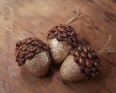 Acorn Ornaments, Champagne, Set of 3 A set of 3 acorn ornaments. These acorn ornaments are handmade with real pine cone pieces, hollow mache cores, and two colors of beautiful crystalline glitter. The (Rustic Christmas Ornaments) Woodland Christmas, Rustic Christmas, Christmas Holidays, Christmas Decorations, Christmas Ornaments, Xmas, Acorn Decorations, Christmas Christmas, Christmas Ideas