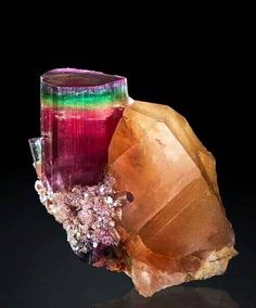 A rainbow of colours in this Tourmaline specimen. Sorry I don't the location. But if you go to this site with photos of beautiful specimens you may learn more. If you can read Japanese.