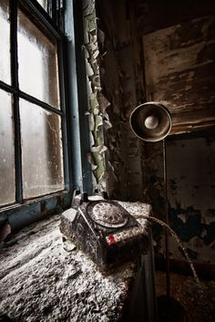 decaying- Odd that in most photos of abandoned places with phones, the phone is off the hook as if someone was trying to make a call and was taken or got called away...