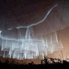 "Aurora over Finland . . .""the hem of His garment . . ."""