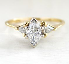 Diamond Three Stone Engagement Anniversary Estate Ring Magic Glo 14kt Yellow Gold Marquise And Trillian Diamonds Half Carat. $389.00, via Etsy.