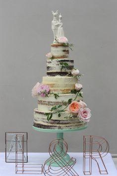 Whimsical semi naked wedding cake By www.andifreemancakes.co.uk