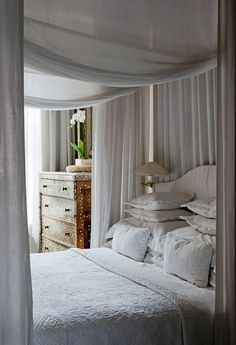 Cottage Bedroom With Canopy and Creamy Bedscape.