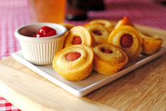 How adorable! A fun twist on corn dogs, these mini Corn Dog Muffins make a great appetizer or quick snack. They're also easily made gluten-free. Corn Dog Muffins, Mini Muffins, Sausage Muffins, I Love Food, Good Food, Yummy Food, Mini Corn Dogs, Muffin Tin Recipes, Muffin Tins