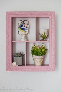 I'm so excited to share today how we made an easy DIY Shadow Box for our farmhouse girl's nursery full of charm and girly touches.