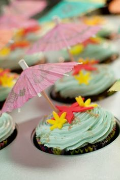 Hawaiian cupcakes. Love the topping idea with umbrellas and shapes