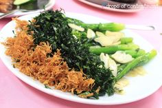 Yin yang chinese style kai-lan. The leaves are julienned and deep fried, and the stalk stir fried.