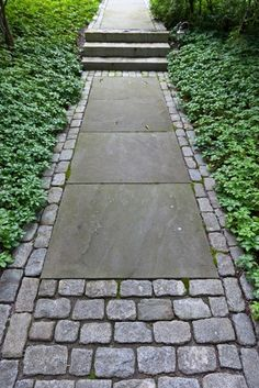 Recycled cobble pavers and manufactured stone - great use of old and new materials to create an interesting walkway.