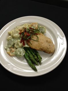 Parmesan crusted chicken and pesto tortellini    http://www.westmichigancaterer.com