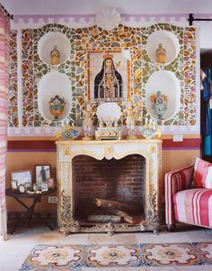 The Turkish fireplace is decorated with Sicilian religious items.   - HarpersBAZAAR.com