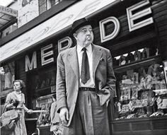 French Poet Jacques Prévert (1900 - 1977) photographed by Robert Doisneau : Devant la porte de l'usine le travailleur soudain s'arrête le beau temps l'a tiré par la veste et comme il se retourne tout rouge tout rond souriant dans son ciel de plomb il cligne de l'œil familièrement. Dis donc, camarade soleil tu ne trouves pas que c'est plutôt con de donner une journée pareille à un patron ? »