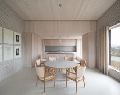 Influenced by both Benedictine monasteries and Japanese residences, award-winning British architect John Pawson created The Life House – a minimalist holiday rental home in Wales with a pure and uncluttered ambience that encourages a state of quietude and contemplation. Tagged: Dining Room, Table, Chair, and Pendant Lighting. Photo 20 of 21 in 10 Zen Homes That Champion Japanese Design