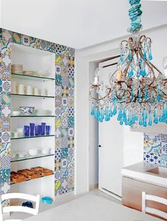 Cool use of patchwork effect with tiles .... finished with a fantastic chandellier!!