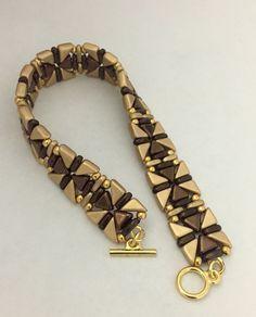 Gold/Dark Bronze bracelet made with Tango and Kheop beads. Design by Beautiful Rain Jewelry, USA Seed Bead Jewelry, Jewelry Making Beads, Bracelet Making, Jewelry Bracelets, Jewellery, Super Duo Beads, Beaded Bracelet Patterns, Handmade Jewelry Designs, Bead Jewelry