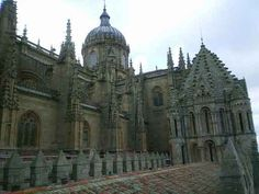 The photographs show a carving of an astronaut on the facade of a cathedral in Salamanca, Spain. Description from hoax-slayer.com. I searched for this on bing.com/images
