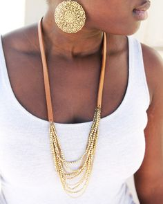 Trades of Hope -   Product Details:       Multi-strands of gold colored beads sway off of leather to create this stunning, yet casual piece.