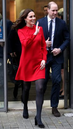 Kate Middleton's Maternity Style December 6: A visit to Manchester calls for a bold red tunic dress from British brand Goat.