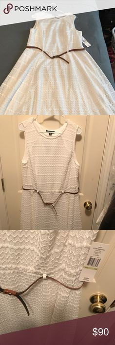 White Sharagano dress. Never worn. Size: 18W This is a dress I bought and never got to wear. It still has the tags. It is a crisp white with a thin brown waist belt. The material is patterned and loose. Sharagano Dresses Midi