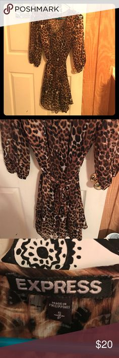 Cheetah print dress 3/4 sleeve cheetah print dress. Only worn a few times. Size small from express. Double layer with a black slip inside. Express Dresses Midi