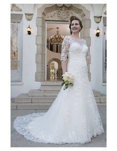 Gorgeous lace gown with sleeves available at Spotlight Formal Wear! #SpotlightBridal