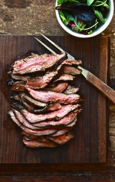 Grilled flank steak. Make mine with a chunky garlic rosemary marinade. Heavy on the garlic.
