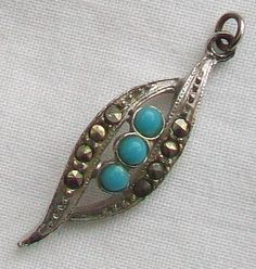A small leaf shaped pendant in silver tone decorated with marcasite and turquoise coloured stones All stone are intact Measurement the pendant is Turquoise Color, Turquoise Stone, Small Leaf, Leaf Shapes, Marcasite, Stone Pendants, Stones, Silver, Vintage