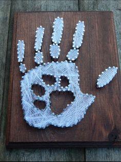 Paw print in hand print string art