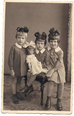 3 sisters with a huge doll, Latvia, 1937
