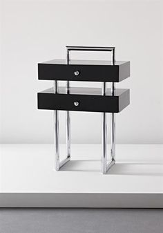 JACQUES ADNET Rare small cabinet, ca. 1928 Wood, original chrome-plated tubular metal. 29 3/4 x 19 1/4 x 15 in. (75.5 x 49.8 x 38 cm.)