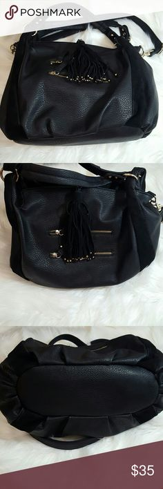 "Urban outfitters black handbag Cute and classic black purse by ecote from urban outfitters. Very on trend tassel charm and gold zippers on front. Faux leather with faux suede accents and detachable straps. Magnetic closure. Inside has zip pocket & 2 slip pockets.  Approx 15"" long x 13"" tall x 7"" wide 10"" Strap drop, 25-35"" crossbody strap Urban Outfitters Bags Totes"