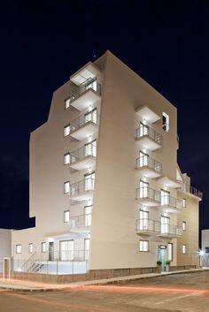 white architecture, catania bulding, la vela by night
