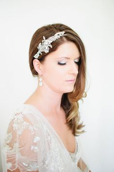 A simple, wavy hairstyle with an embellished headband | @canarygrey | Brides.com
