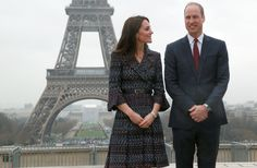 Je t'aime! Prince William and Duchess Kate blend business and romance in Paris, looking loving at the Eiffel Tower