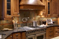#Kitchen Idea of the Day: Rustic Kitchen Design with Slate Tile Backsplash and pot filler faucet.