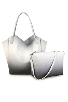 Soft ombrevegan leathertote that includes a separate pouch that could be used as a cross body bag.    Dimensions: 59 x 39 x 13 cm   Vegan Leather Tote by Pixie Mood. Bags - Totes Florida