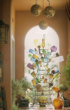 Indoor Bottle Tree - very interesting take on a traditional outdoor decoration
